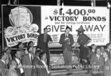 """$1,400.00 in Victory Bonds and war savings certificates given away"""